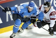 In this Tuesday, May 14, 2013, file photo, Finland's Juhamatti Aaltonen, left, vies for the puck with Latvia's Ralfs Freibergs during a 2013 IIHF World Championships Group B preliminary round match in Helsinki. (AP Photo/Lehtikuva, Jussi Nukari, File)