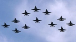 CF-18s fly in formation (Fred Chartrand / THE CANADIAN PRESS)
