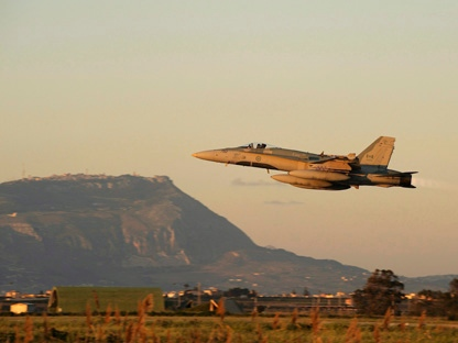 A Canadian CF-18 Hornet of the 425th Tactical squadron takes off from Trapani, Italy on Tuesday, March 22, 2011, heading over the Mediterranean Sea. Canadian fighter pilots participated in NATO bombing missions over Libya. (THE CANADIAN PRESS/HO, DND - Cpl. Marc-Andre Gaudreault)