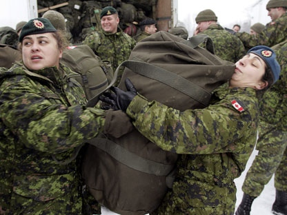 Female members of the Canadian Forces DART (Disaster Assistance Response Team) unload their kits from trucks in Trenton, Ont., Thursday, Jan. 6, 2005 before being deployed to Sri Lanka. (CP PHOTO/Tom Hanson)