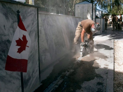 Canadian Forces engineers dismantle the Canadian War Memorial at Kandahar Air Field Saturday, November 12, 2011 in Kandahar, Afghanistan. The entire monument will be shipped to Canada and reassembled in the Ottawa area after the final Remembrance Day ceremony was held here yesterday.THE CANADIAN PRESS/Ryan Remiorz