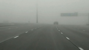 Thick fog causes poor visibility on Highway 401 in Toronto in this file photo.