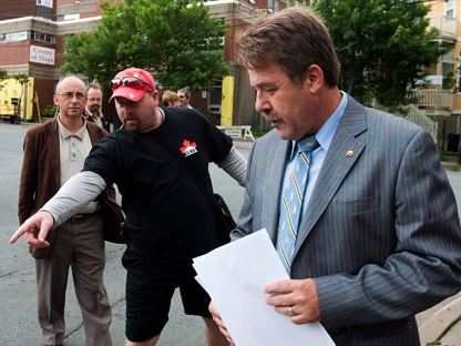 Peter Stoffer, the NDP veterans affairs critic, is accompanied by veteran Dennis Manuge, left, in Halifax on Friday, Aug. 5, 2011. (THE CANADIAN PRESS/Andrew Vaughan)