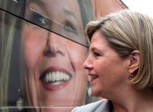 Ontario NDP leader Andrea Horwath walks past her bus as she arrives at Paintbox Bistro on a campaign stop in Toronto on Thursday, May 15, 2014. (The Canadian Press/Frank Gunn)