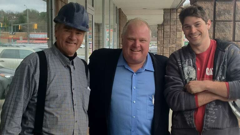 Rob Ford poses with construction workers outside a café in Bracebridge, Ont., Friday, May 16, 2014.