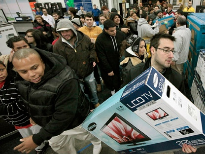 Black�Friday shoppers rush into Best Buy in North Dartmouth, Mass., early Friday, Nov. 25, 2011. Thousands of shoppers lined up at Macy's, Best Buy and other stores nationwide to buy everything from toys to tablets on Black Friday despite the economic downturn and some planned protests of the shopping holiday. (AP Photo/The Standard-Times, Peter Pereira)