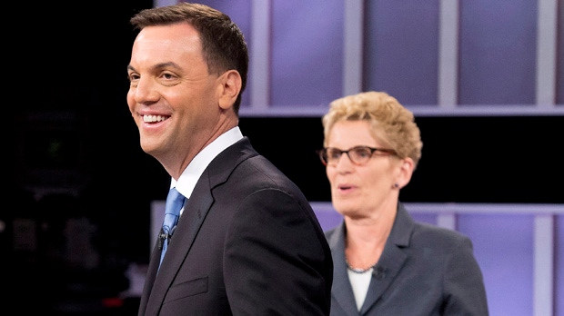 Ontario PC leader Tim Hudak, left, laughs next to Ontario Premier Kathleen Wynne, right, after taking part in the live leaders debate at CBC during the Ontario election in Toronto on Tuesday, June 3, 2014. THE CANADIAN PRESS/Frank Gunn