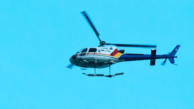 RCMP Helicopter searches for the gunman in Moncton, N.B.on Wednesday June 4, 2014. The RCMP in New Brunswick says an undisclosed number of people have been shot and a manhunt is underway in the north end of Moncton for a man armed with guns. THE CANADIAN PRESS/Marc Grandmaison