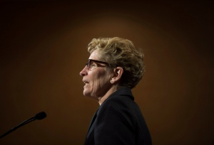 Ontario Liberal Leader Kathleen Wynne speaks to reporters following a meeting with a group of Ontario mayors in Toronto, Ont. on Thursday, June 5, 2014. THE CANADIAN PRESS/Darren Calabrese