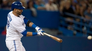 Toronto Blue Jays Jose Bautista hits into a triple play against the St. Louis Cardinals during 6th inning inter-league action in Toronto on Friday June 6, 2014. THE CANADIAN PRESS/Frank Gunn