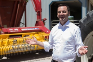 Ontario PC Leader Tim Hudak visits a dairy farm in Wilmot Township, Ontario, on Friday June 7, 2014 as he continues his election campaign. (Chris Young /The Canadian Press)