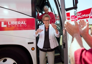 Ontario Liberal Leader Kathleen Wynne, centre, and her partner Jane Rounthwaite are greeted by supporters while arriving at a campaign stop in Waterdown, Ont., on Saturday, June 7, 2014. (The Canadian Press/Darren Calabrese)