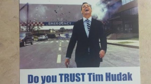 """A flyer depicting Ontario PC leader Tim Hudak laughing as he walks away from an exploding hospital is shown. Ontario Premier Kathleen Wynne says the Liberal flyer sent by a Vaughan candidate is """"not acceptable."""" (The Canadian Press/HO)"""