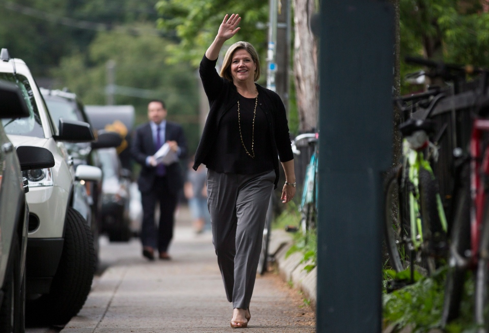 NDP Leader Andrea Horwath waves to volunteers in the early hours of election day in Toronto's Kensington Market on Thursday, June 12, 2014. (The Canadian Press/Michelle Siu)