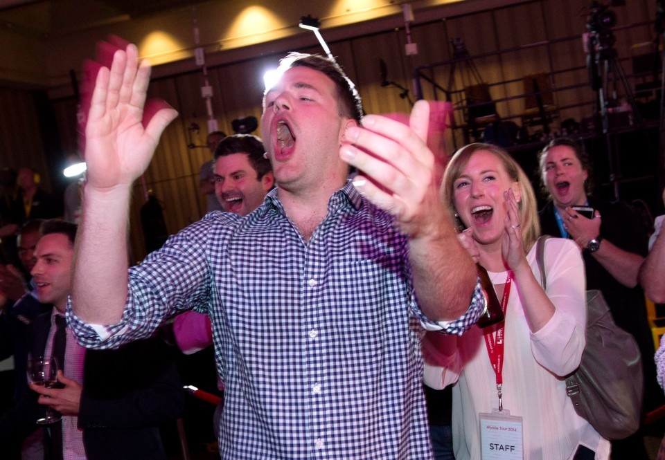 Liberal supporters celebrate while watching the results of the Ontario Provincial Election on a television at the Liberal party's election night headquarters in Toronto on Thursday, June 12, 2014. (The Canadian Press/Darren Calabrese)