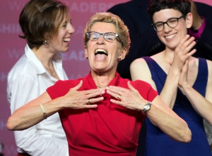 Ontario Premier Kathleen Wynne celebrates on stage with her family after winning the provincial election in Toronto on Thursday June 12, 2014. (Frank Gunn /The Canadian Press)