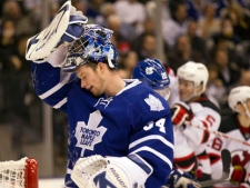 Toronto Maple Leafs goaltender James Reimer reacts as the New Jersey Devils celebrate their second goal during first period NHL action in Toronto on Tuesday, Dec. 6, 2011. (THE CANADIAN PRESS/Frank Gunn)