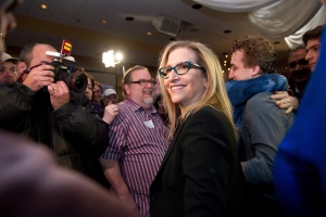 Ontario PC candidate for Thornhill Gila Martow celebrates a victory in the Thornhill byelection with her son Evan, right, on Thursday, Feb. 13, 2014. (The Canadian Press/Galit Rodan)