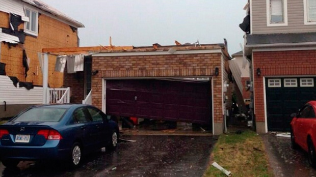 Damage to houses is shown in Angus, near Barrie, Ontario on Tuesday, June 17, 2014. Provincial police say there are reports of some minor injuries after severe weather ripped through the central Ontario community of Angus. (The Canadian Press/Julie Wilhelm)