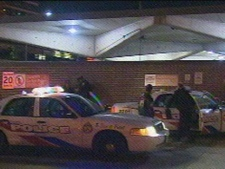 Police cruisers are seen outside Finch Station Saturday night. (CP24)