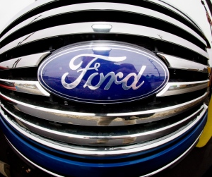 In this Oct. 29, 2009 file photo made with a fisheye lens, the Ford logo is shown on the grill of a pickup truck on a Ford dealership in Wexford, Pa. (AP Photo/Keith Srakocic)