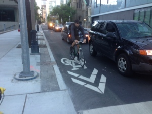 A cyclist travels along a bike lane downtown on Wednesday, July 8, 2014. (Cam Woolley/CP24)
