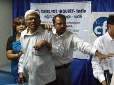 Organizers try to protect Bangladeshi writer Taslima Nasrin, far left, as he is attacked by Muslim protesters, unseen during her book release in Hyderabad, India on Thursday, Aug 9, 2007. Nasrin escaped unhurt as the organizers pushed back nearly 100 protesters, led by three lawmakers. In the melee, one of the protesters slapped her and told her to go back to her country, according to eyewitnesses. (AP Photo/Mahesh Kumar A)