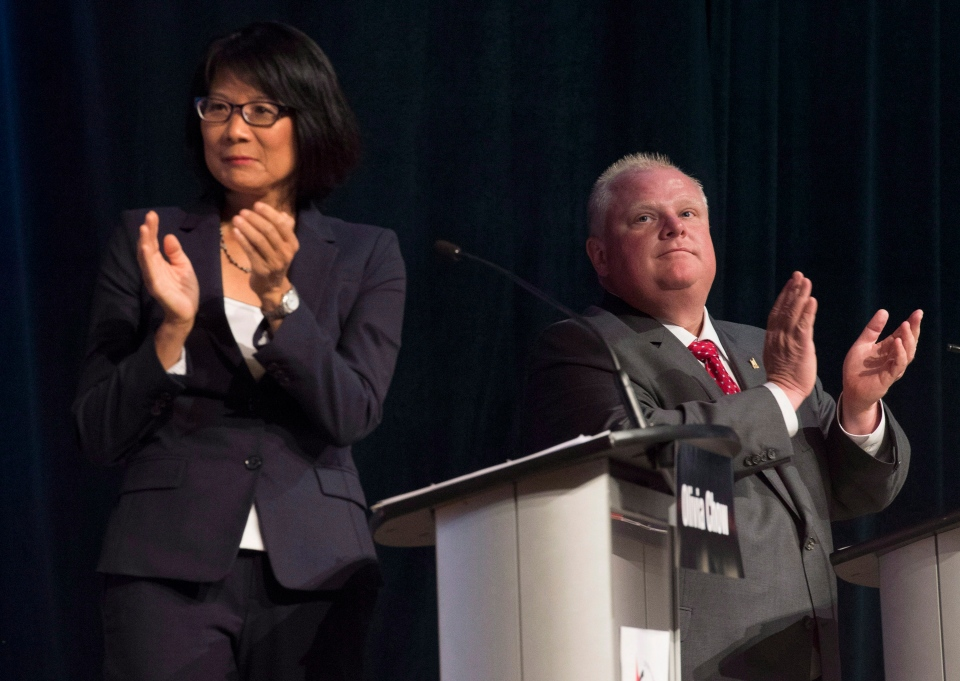 Toronto mayoral candidates Rob Ford, right, and Olivia Chow participate in a mayoral debate in Toronto on Tuesday, July 15, 2014. THE CANADIAN PRESS/Darren Calabrese