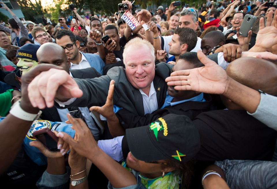 Mayor Rob Ford makes his way through thousands of people at Ford Fest in Toronto on Friday, July 25, 2014. (The Canadian Press/Darren Calabrese)