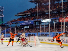 Philadelphia Flyers' Brayden Schenn, right, celebrates his goal in the second period of the NHL Winter Classic hockey game against the New York Rangers, Monday, Jan. 2, 2012, in Philadelphia. (AP Photo/Tom Mihalek)
