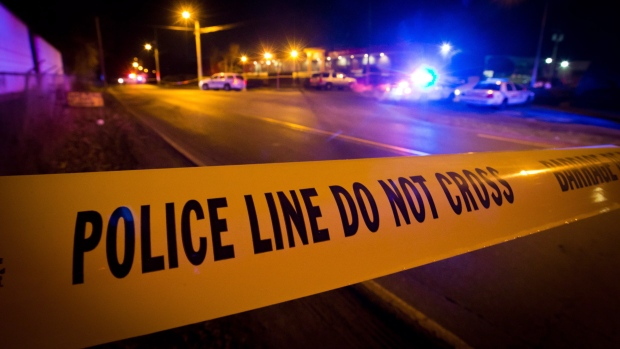 Police tape is shown in a file photo. (The Canadian Press/Darryl Dyck)
