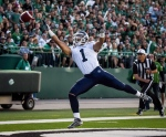 Toronto Argonauts' Anthony Coombs misses a pass in the end zone during the first quarter of CFL football action against the Saskatchewan Roughriders in Regina, Sask., on Saturday, July 26, 2014. (The Canadian Press/Matt Smith)