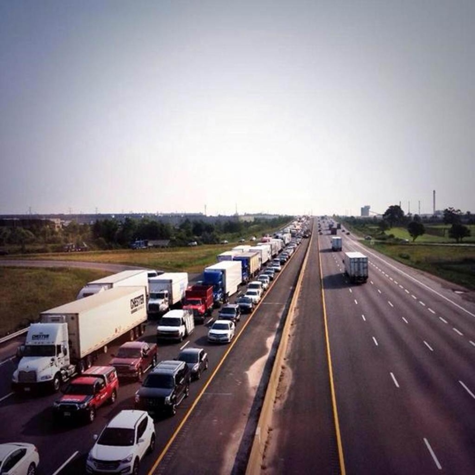 A backlog of traffic is shown on Highway 401 west Thursday, Aug. 7, 2014. (@graceofrhythm/Twitter)