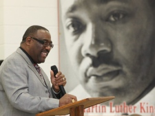 Pastor James L. Smith speaks during a celebration of the life and legacy of Dr. Martin Luther King Jr. at Palmer Grover Baptist Church in Kingston, N.C., on Sunday, Jan. 15, 2012. (AP Photo/The Star, Ben Earp)