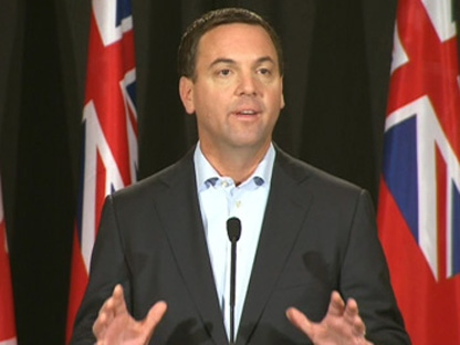 Ontario PC leader Tim Hudak speaks to reporters in this Friday, Oct. 7, 2011, file photo.