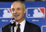 Major League Baseball Chief Operating Officer Rob Manfred speaks to reporters after team owners elected him as the next commissioner of Major League Baseball during an owners quarterly meeting in Baltimore on Thursday, Aug. 14, 2014. (AP Photo/Steve Ruark)