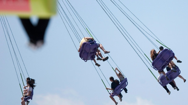 Visitors to the Canadian National Exhibition enjoy a ride. (The Canadian Press/Chris Young)