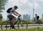 Cyclists ride past the skyline in Toronto on Wednesday, June 26, 2012. (Frank Gunn / THE CANADIAN PRESS)