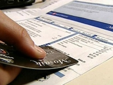 A credit card and statement are pictured in this file photo.