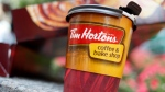 In this Wednesday, July 22, 2009, file photo, a Tim Hortons coffee cup is seen in New York. (AP / Seth Wenig)