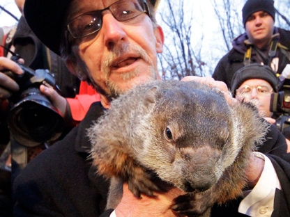 Groundhog Club handler Ron Ploucha holds Punxsutawney Phil, the weather prognosticating groundhog, during the 126th celebration of Groundhog Day on Gobbler's Knob in Punxsutawney, Pa., on Thursday, Feb. 2, 2012. Phil saw his shadow, forecasting six more weeks of winter weather. (AP Photo/Gene J. Puskar)
