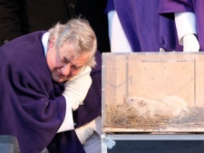 Wiarton, Ont., Mayor John Close lends an ear to Wiarton Willie on Thursday, Feb. 2, 2012. The groundhog didn't see his shadow, predicting an early spring. (THE CANADIAN PRESS/Frank Gunn)