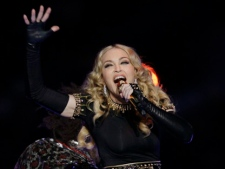Madonna performs during halftime of the NFL Super Bowl XLVI between the New York Giants and the New England Patriots on Sunday, Feb. 5, 2012, in Indianapolis. (AP Photo/Mark Humphrey)