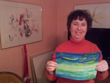 Sari Alter, a local artist and writer, surrounded by her work at her Toronto home. (Sandie Benitah/CP24)