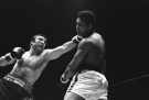 In this May 1, 1972, file photo, George Chuvalo connects with a left to the head of Muhammad Ali in the first round of their scheduled 12-round fight in Vancouver. (AP Photo)