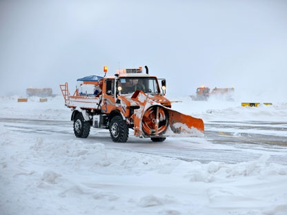 A snow plough clears the tarmac at Slatina airport, Kosovo, Thursday, Feb. 2, 2012. Exceptionally cold weather and snowstorms have affected parts of central and eastern Europe, as dozens of flights were canceled Thursday by inclement weather. (AP Photo/Visar Kryeziu)