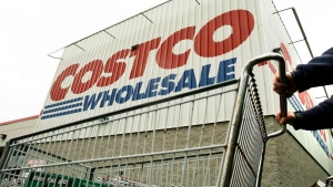 A shopper pushes a cart outside Costco Wholesale in Danvers, Mass. in this May 27, 2009 file photo. (AP Photo/Elise Amendola, File)