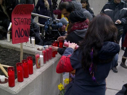 A group calling itself Justice for Migrant Workers held a demonstration in Toronto on Friday, Feb. 17, 2012, to call for inquests into a crash that killed 11 people near Hampstead, Ont., and a farm accident that killed two workers in 2010. (CP24/Katie Simpson)