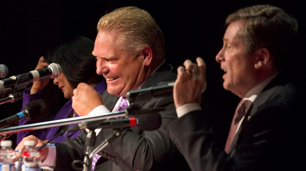 Doug Ford (centre) reacts to a point being made by John Tory (right) takes part in a Toronto Mayoral Debate, with Olivia Chow in Toronto on Tuesday, September 23, 2014. The debate represented his first appearance with other candidates since his belated entry into the race following the last minute withdrawal by his brother and incumbent Mayor Rob Ford for health reasons. THE CANADIAN PRESS/Chris Young