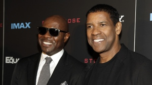 "Antoine Fuqua, left, and Denzel Washington, attend a screening of ""The Equalizer"" on Monday, Sept. 22, 2014 in New York. (Photo by Andy Kropa/Invision/AP)"
